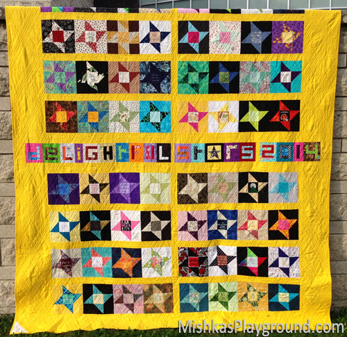 The back of my quilt includes friendship stars and paper pieced letters sent from quilters around the world.